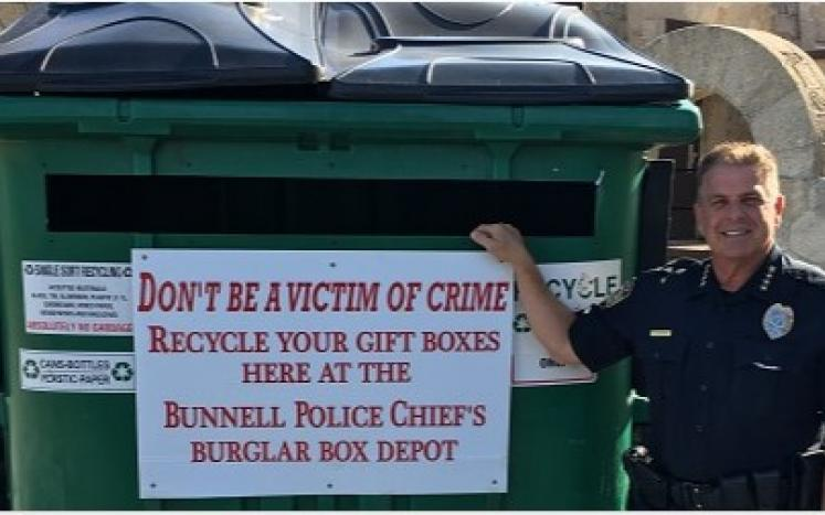 Photo: Chief Foster in front of the Burglar Box Depot at the Coquina Building